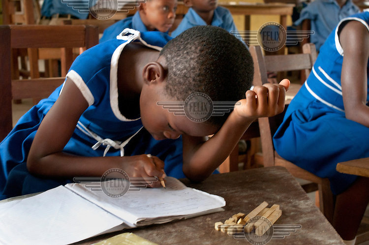 School children write in their work books during a lesso at the Riis Presby Model Primary.
