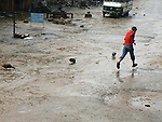 A boy runs through puddles to escape heavy rain in Bungmati. The ducks seemed to enjoy it...