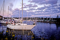 A sailboat motors out of LaPoint Harbor on Madeline Island, Ashland County, Wisconsin