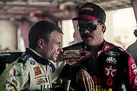 DAYTONA BEACH, FL - JUL 2, 1994:  Mark Martin, L, talks with Ernie Irvan in the garage before the Pepsi 400 NASCAR Winston Cup race at Daytona International Speedway, Daytona Beach, FL. (Photo by Brian Cleary/www.bcpix.com)