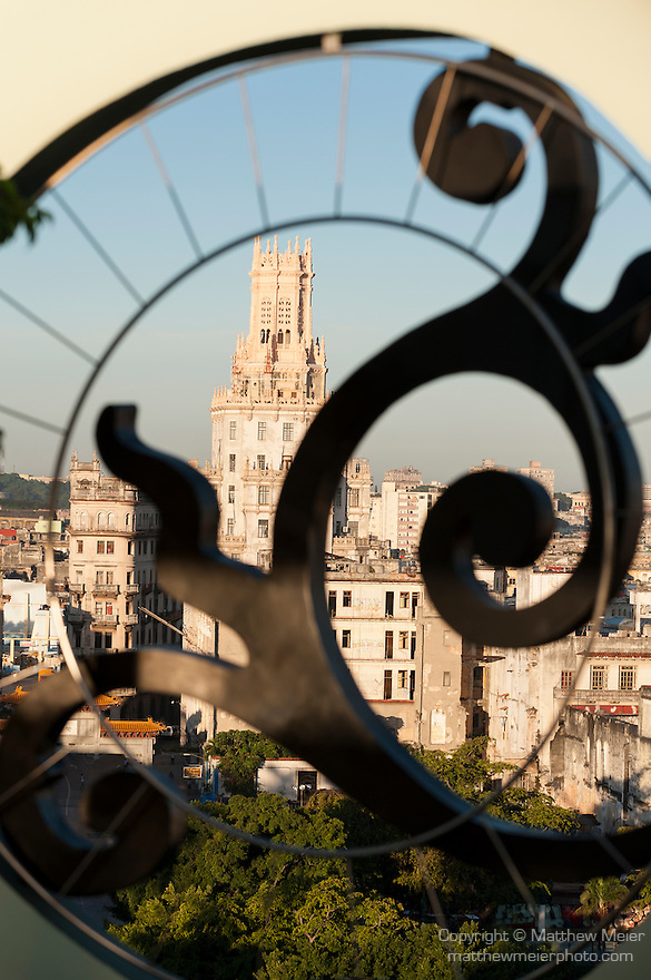 Havana, Cuba; the Dragon Gate across Calle Dragones, announces the entrance to China Town, viewed through an architectural element on the roof of the Saratoga Hotel in early morning sunlight