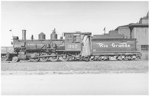 Fireman's-side view of D&amp;RGW #317 at Montrose engine house.<br /> D&amp;RGW  Montrose, CO  5/1948