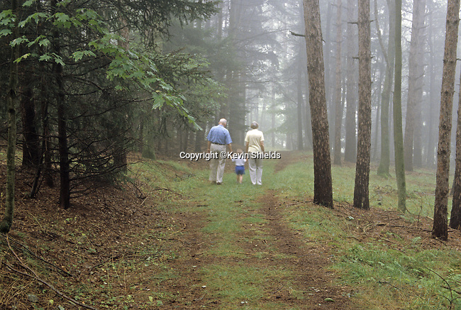 Grandparents walking with their grandson