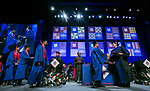 Ray Whittington, dean of the Driehaus College of Business, congratulates students Sunday, June 11, 2017, during the DePaul University Driehaus College of Business commencement ceremony at the Allstate Arena in Rosemont, IL. (DePaul University/Jamie Moncrief)