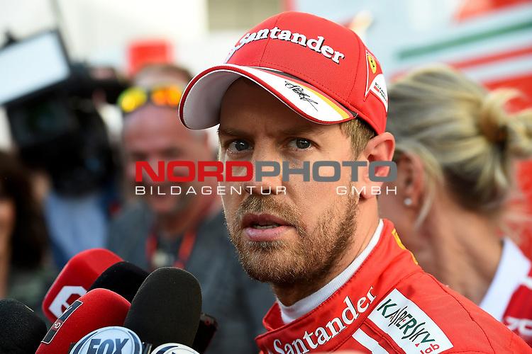 28.04.2017, Sochi Autodrom, Sochi, FORMULA 1 VTB RUSSIAN GRAND PRIX,  28.04. - 30.04.2017<br /> Sebastian Vettel (GER#5), Scuderia Ferrari im Fernsehinterview<br /> <br /> <br /> <br /> Foto &copy; nordphoto / Bratic