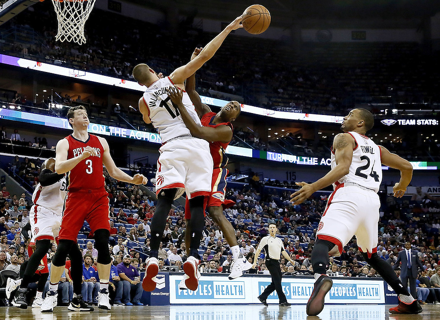 NEW ORLEANS, LA - MARCH 26: Jonas Valanciunas #17 of the Toronto Raptors blocks a shot from Toney Douglas #16 of the New Orleans Pelicans during a game at the Smoothie King Center on March 26, 2016 in New Orleans, Louisiana. NOTE TO USER: User expressly acknowledges and agrees that, by downloading and or using this photograph, User is consenting to the terms and conditions of the Getty Images License Agreement.  (Photo by Jonathan Bachman/Getty Images)