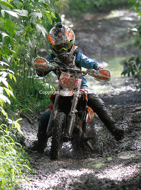 THOMASTON, CT - 19 AUGUST 2017 - 081917JW02.jpg -- Ryan Amancio of New Milford blasts through the mud to win the AMA 50CC Senior division during the Pathfinders Motorcycle Club of Connecticuts Dam Good National Hare Scramble Saturday morning at Thomaston Dam. Riding continues Sunday with the PRO/AM series. Jonathan Wilcox Republican-American