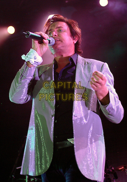 "SIMON LEBON.DURAN DURAN perform during a stop of their ""Astronaut"" Tour held at the Chevrolet Ampitheater at Station Square..Pittsburgh, USA United States .August 2nd 2005.Ref: ADM/JN.half length singer perform performing live concert gig stage microphone glittery sparkley jacket.www.capitalpictures.com.sales@capitalpictures.com.© Capital Pictures."