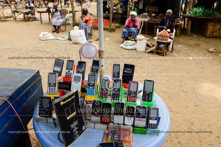 KENYA, Bukura, street vendoor selling mobile phones of Nokia, Tecno, oking / KENIA, County Kakamega, Bukura, Markt mit Stand fuer Mobiltelefone
