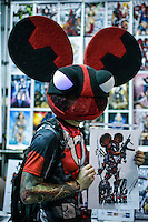 A reveller buys a poster while he attends the annual event Comic Con at the Javits center in New York.  09.05.2014. Eduardo Munoz Alvarez/VIEWpress