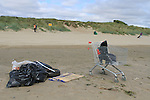 Bettystown Beach being cleaned up...(Photo credit should read Jenny Matthews www.newsfile.ie)....This Picture has been sent you under the conditions enclosed by:.Newsfile Ltd..The Studio,.Millmount Abbey,.Drogheda,.Co Meath..Ireland..Tel: +353(0)41-9871240.Fax: +353(0)41-9871260.GSM: +353(0)86-2500958.email: pictures@newsfile.ie.www.newsfile.ie.