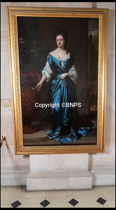 BNPS.co.uk (01202 558833)<br /> Pic: PhilYeomans/BNPS<br /> <br /> The lifesize portrait of Queen Anne by leading court artist Sir Godfrey Kneller.<br /> <br /> The real-life characters behind Olivia Colman's Oscar-tipped film The Favourite have been reunited as part of Blenheim Palace's annual deep clean.<br /> <br /> The portraits of Queen Anne, played by Colman in the film, and Sarah, the first Duchess  of Marlborough, who was portrayed by Rachel Weisz, have been brought together in Blenheim's Great Hall to allow a team of specialist's to undertake the winter clean.<br /> <br /> The film, a historical comedy/drama, depicts the tumultuous relationship between the pair in the early 18th century.<br /> <br /> The land to build Blenheim was gifted to the first Duke and Duchess by Queen Anne after John Churchill's stunning pan-european alliance defeated Louis XIV of France.<br /> <br /> Despite Anne gifting them the land to build the magnificent Palace she also eventually stripped them of their official roles at Court after falling out with strong minded Duchess.