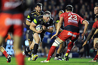 Henry Thomas of Bath Rugby takes on the Toulon defence. European Rugby Champions Cup match, between RC Toulon and Bath Rugby on January 10, 2016 at the Stade Mayol in Toulon, France. Photo by: Patrick Khachfe / Onside Images