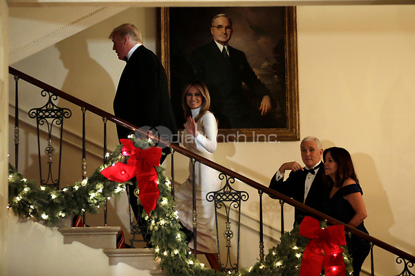 United States President Donald J. Trump, First Lady Melania Trump, US Vice President Mike Pence, and Karen Pence ascend the Grand Staircase in front of the portrait of US President Harry S. Truman after greeting guests at the Congressional Ball at White House in Washington on December 15, 2018. <br /> Credit: Yuri Gripas / Pool via CNP / MediaPunch