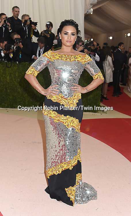 Demi Lovato attends the Metropolitan Museum of Art Costume Institute Benefit Gala on May 2, 2016 in New York, New York, USA. The show is Manus x Machina: Fashion in an Age of Technology. <br /> <br /> photo by Robin Platzer/Twin Images<br />  <br /> phone number 212-935-0770