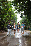 USA, Oahu, Hawaii, portrait of MMA Mixed Martial Arts Ultimate fighter Lowen Tynanes, Logan Garcia, Tyson Tynanes and Kyla Tipps on the path to Pipeline on the North Shore of Oahu