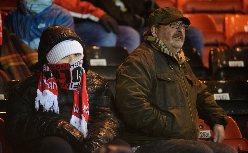 Lincoln City fans watch their team in action<br /> <br /> Photographer Chris Vaughan/CameraSport<br /> <br /> The EFL Sky Bet League Two - Saturday 15th December 2018 - Lincoln City v Morecambe - Sincil Bank - Lincoln<br /> <br /> World Copyright © 2018 CameraSport. All rights reserved. 43 Linden Ave. Countesthorpe. Leicester. England. LE8 5PG - Tel: +44 (0) 116 277 4147 - admin@camerasport.com - www.camerasport.com