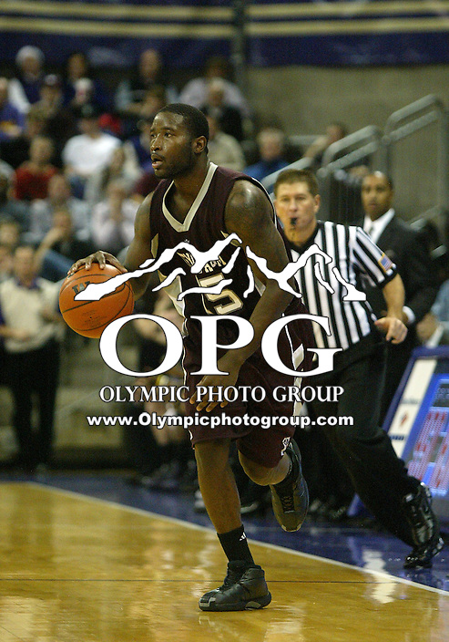 22 December 2009:  Texas A&M guard #15 Donald Sloan brings the ball down court against Washington. Washington won 73-64 over Texas A&M at the Bank of America Arena in Seattle, WA.