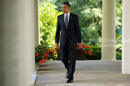 United States President Barack Obama arrives to discuss the U.S. Senate vote to end debate on a financial regulation bill in the Rose Garden of the White House in Washington on Thursday, May 20, 1010.  .Credit: Roger L. Wollenberg - Pool via CNP
