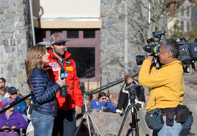 Travis Ganong does an interview before the Olympic Homecoming  Celebration at Squaw Valley on Friday night, March 21, 2014.