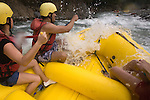 TURRIALBA, COSTA RICA- JANUARY 2, 2009:  Meredith Miller (R), 23, of Queens; Glenn Sáenz (C), 23, of Jersey City; and his cousin Gaby Quirós (L), 21, of San Jose; white-water raft on the Pacuare River with Rios Tropicales on January 2, 2009 in Turrialba, Costa Rica.    (Photo by Michael Nagle)