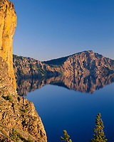 USA, Oregon, Crater Lake National Park, Yellow lichens at Palisade Point overlook Crater Lake with Dutton Cliff in the right distance.