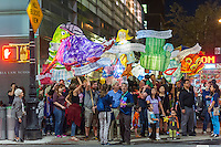 "Local residents joined by Columbia University students and faculty carry lanterns in the 5th annual Morningside Lights procession on Saturday, September 24, 2016. Produced by Columbia University Arts Initiative and Miller Theatre, the paper-mâché illuminated lanterns  fulfilled the theme of this years' procession; ""Traverse: 100 Years of Pulitzer Poetry"". The parade woound its way through Morningside Park eventually ending at the Columbia campus.  (© Richard B. Levine)"