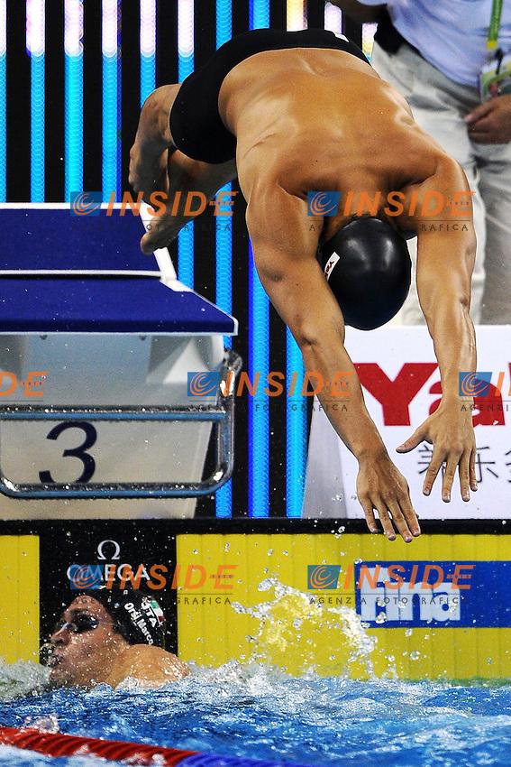 Cambio Michele SANTUCCI e Marco ORSI Italia.Men's 4x100m Freestyle - Swimming / Nuoto.Shanghai 24/7/2011 .14th FINA World Championships.Foto Andrea Staccioli Insidefoto