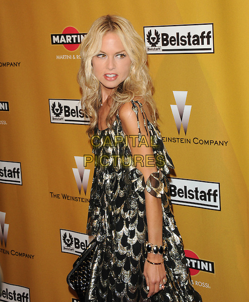 RACHEL ZOE.At Weinstein Company Post Golden Globe Party held at Bar210 & Plush Ultra Lounge in Beverly Hills, California, USA. January 17th, 2010                                                                   globes half length black gold pattern print dress off the shoulder metallic cut out away bag purse looking over bracelets   .CAP/DVS.©Debbie VanStory/Capital Pictures