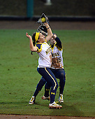 Michigan Wolverines Softball infielder Abby Ramirez (1) and outfielder Nicole Sappingfield (15) collide during a game against the University of South Florida Bulls on February 8, 2014 at the USF Softball Stadium in Tampa, Florida.  Michigan defeated USF 3-2.  (Copyright Mike Janes Photography)