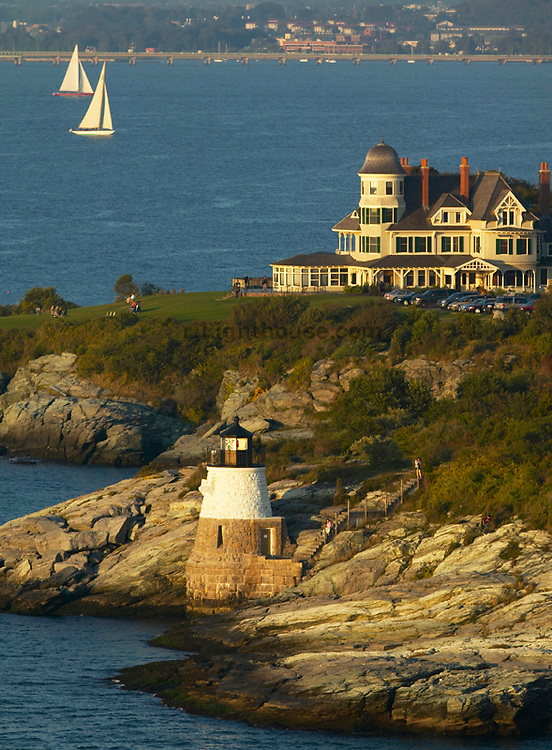 An aerial view of Castle HIll Lighthouse and Inn with 12 Meters racing back to Newport Harbor.