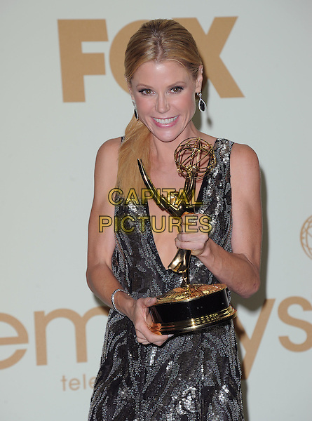 Julie Bowen.The 63rd Anual Primetime Emmy Awards held at Nokia Theatre L.A. Live in Los Angeles, California, USA..September 18th, 2011.half length award trophy winner black grey gray silver sequins sequined dress sleeveless.CAP/RKE/DVS.©DVS/RockinExposures/Capital Pictures.