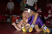 Junior Shawn Harmon wrestles against San Francisco State on November 14, 2000 at Burnham Pavilion.