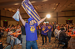 Team Waterford Lakes wave a flag as they come forward for recognition during a team building weekend in Orlando for Ashley Furniture.