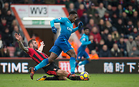 Steve Cook of AFC Bournemouth tackles Danny Welbeck of Arsenal during the Premier League match between Bournemouth and Arsenal at the Goldsands Stadium, Bournemouth, England on 14 January 2018. Photo by Andy Rowland.