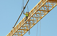 NWA Arkansas Democrat-Gazette/DAVID GOTTSCHALK  A worker continues to dismantle Thursday, September 13, 2018, a tower crane at the TheatreSquared construction site in Fayetteville. Baldwin and Shell Construction was approved for a temporary road closure permit of West Spring Street Thursday and today from 8:00 a.m. to 5:00 p.m. for the removal. Designed by Marvel Architects and Charcoalblue, the 50,000-square-foot building will feature two theaters, a rehearsal space, offices, education and community space, on-site design and building workshops, eight guest artist apartments, three levels of outdoor public spaces and a cafe and bar that will remain open during the day. TheatreSquared organizers hope to open in time for the 2019-2020 season.