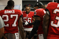 TAMPA, FL - DECEMBER 15: Linebacker Dekoda Watson #56 of the Tampa Bay Buccaneers huddles with the defense in the locker room during the game against the San Francisco 49ers at Raymond James Stadium on December 15, 2013, in Tampa, Florida. The Buccaneers lost 33-14. (photo by Matt May/Tampa Bay Buccaneers)