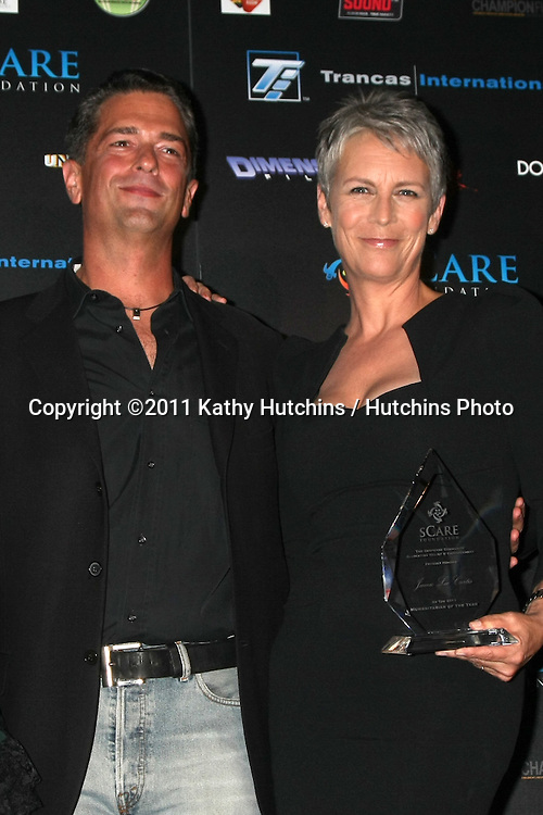 LOS ANGELES - OCT 30:  Malek Akkad, Jamie Lee Curtis at the sCare Foundation Halloween Launch Benefit at Conga Room @ LA Live on October 30, 2011 in Los Angeles, CA