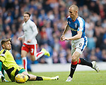 Kenny Miller rounds the keeper but Mark Kerr clears off the line