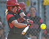 Victoria Nowak #17, Plainedge pitcher, extends her team's lead over Island Trees to 4-2 with a run-scoring single in the bottom of the fifth inning of a Nassau County varsity softball game at Schwarting Elementary School in North Massapequa on Monday, May 1, 2017. Tied 2-2 after four and half innings, Plainedge plated six runs in the frame and went on to win by a score of 10-5.