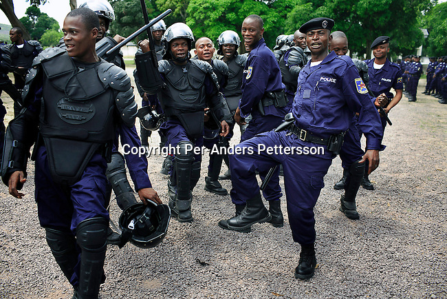 KASANGULU, DEMOCRATIC REPUBLIC OF CONGO APRIL 25: Unidentified riot policemen sing and dance after a demonstration during a graduation ceremony on April 25, 2006 in Kasangulu, outside Kinshasa, Congo, DRC. The European Union has a cooperation and training program with the Congolese police. They trained the integrated Police Unit (UPI) at the Police school here. European standard training and equipment was given to them. These riot police are to be deployed during the upcoming election campaign and elections in Congo, DRC. The country is in ruins after forty years of mismanagement by the corrupt dictator and former president Mobuto Sese Seko. He fled the country in 1997 and a civil war started. The country is planning to hold general elections by July 2006, the first democratic elections in forty years. (Photo by Per-Anders Pettersson