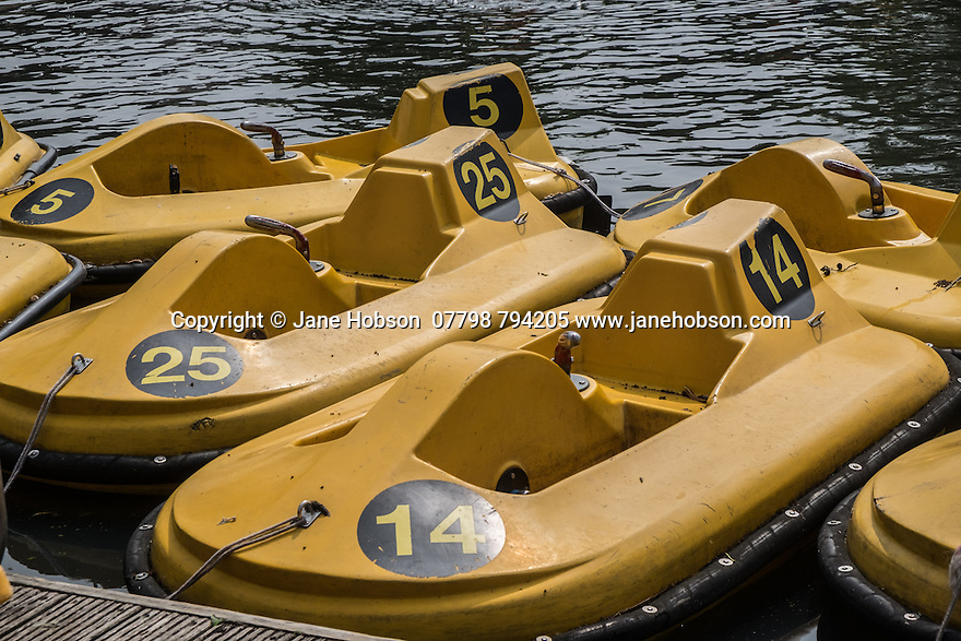 Yellow pedaloes, moored in the children's boating lake, Regent's Park, London, UK.