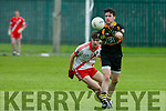 In Action  Stack John Murphy gets away from An Ghaeltacht PJ Mac Laimh  in the   County League Div 1 Austin Stacks v An Ghaeltacht at Connolly Park on Sunday