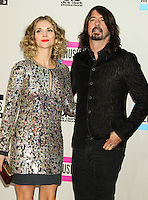 LOS ANGELES, CA - NOVEMBER 24: Jordyn Blum, Dave Grohl arriving at the 2013 American Music Awards held at Nokia Theatre L.A. Live on November 24, 2013 in Los Angeles, California. (Photo by Celebrity Monitor)