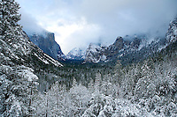 A WIDE ANGLE SHOT OF YOSEMITE VALLEY DURING A SNOWSTORM AT YOSEMITE NATIONAL PARK, CALIFORNIA