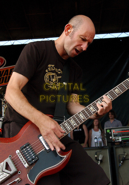 GREG HETSON OF BAD RELIGION.Performs during a tour stop of the '10th Anniversary Vans Warped Tour 2004' held at the Post-Gazette Pavilion, Pittsburgh, PA, USA, August 5, 2004..half length on stage gig music live concert guitar.Ref: ADM.www.capitalpictures.com.sales@capitalpictures.com.©JN/AdMedia/Capital Pictures .