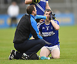 Martin Oige Murphy nurses an injury  during their senior football final replay at Cusack park. Photograph by John Kelly.
