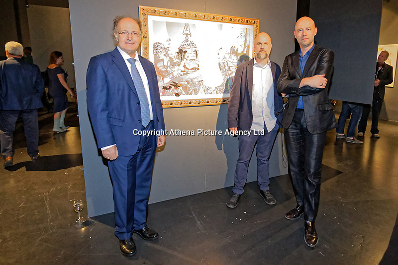 """Pictured L-R: Dionysios Kalavrezos, Greek Ambassador to Belgium, artist Stefanos Rokos and gallerist Peter Bernaerts.  Tuesday 03 September 2019<br /> Re: Opening of """"No More Shall We Part, 14 Paintings, 17 Years Later"""", a collection of paintings based on the Nick Cave and the Bad Seeds album with the same name, by Stefanos Rokos at Bernerts Gallery in Antwerp, Belgium."""