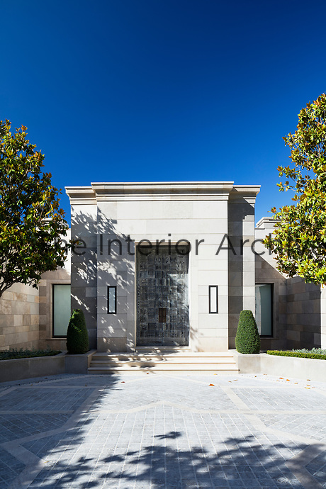 The contemporary villa is a linear design; the front door is stained oak designed by CK and made by John Spencer joinery.
