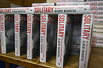 """CORAL GABLES, FL - MAY 17: General view of books on display during Former """"Angola 3"""" inmate Albert Woodfox book signing of  """"Solitary"""" at Books & Books on May 17, 2019 in Coral Gables, Florida. ( Photo by Johnny Louis / jlnphotography.com )"""